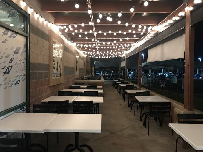 Enjoy a fresh breeze while you dine outdoors in front of our store.