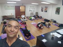 Class of students using rollers to stretch out