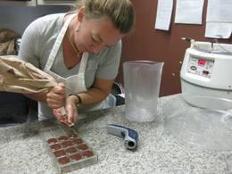 Photo: Woman making chocolate bars