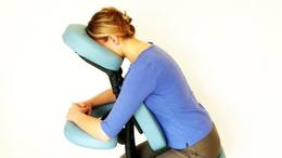 Photo: Woman in a massage chair