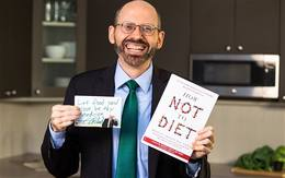 "Dr. Michael Greger holding his new book, ""How Not To Diet"""