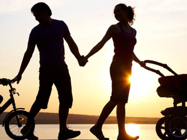 Photo: Family walking during sunset