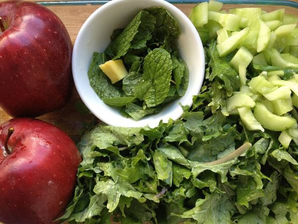 Photo: Chopped Kale, Mint Leaves, Ginger, Apples, and Cucumber