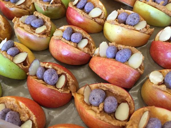 Photo: Sliced apples with candy, sliced almonds and peanut butter