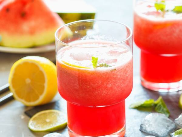 Photo: Watermelon Lemonade with watermelon slices in the background