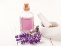 Photo: Lavendar Essential Oil with Lavendar Buds with a Mortar and Pestle