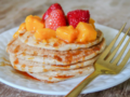 Photo: Pancakes with fresh fruit and syrup on top
