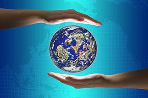 Photo Illustration: Hands Holding a Globe
