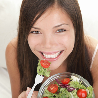 Photo: Woman Eating a Fresh Garden Salad