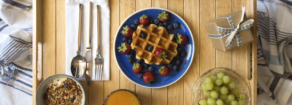 Breakfast Table with Fruit, Waffles, Grapes and Orange Juice