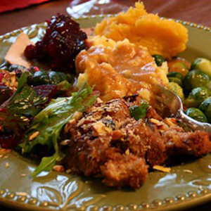 Photo: Plate with Stuffing, Salad, Squash and Cranberry Sauce