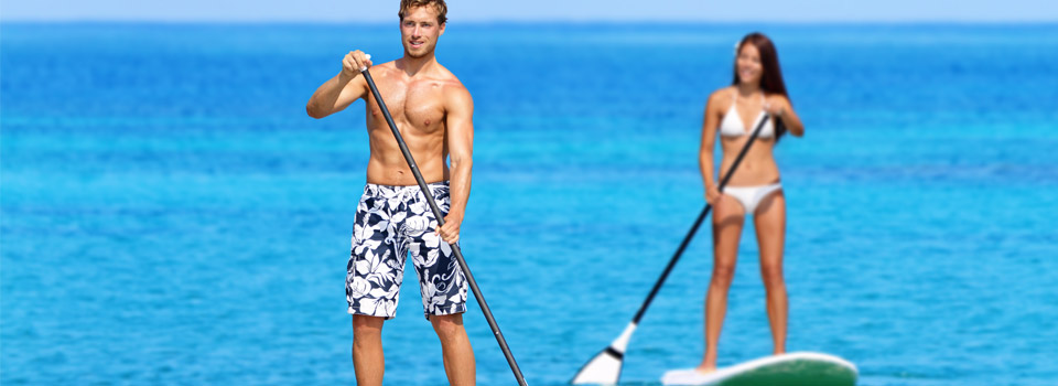 Photo: Man and Woman on Stand-Up Paddleboards