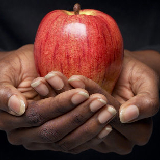 Photo: Hands Holding an Apple
