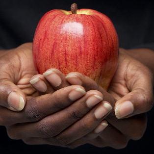 Photo: Hands Holding an Apple