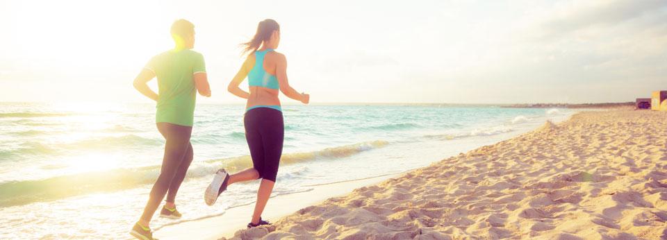 Photo: Couple Running on the Beach
