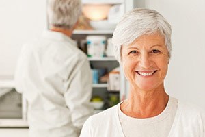 Photo: Older Woman Smiling in the Kitchen