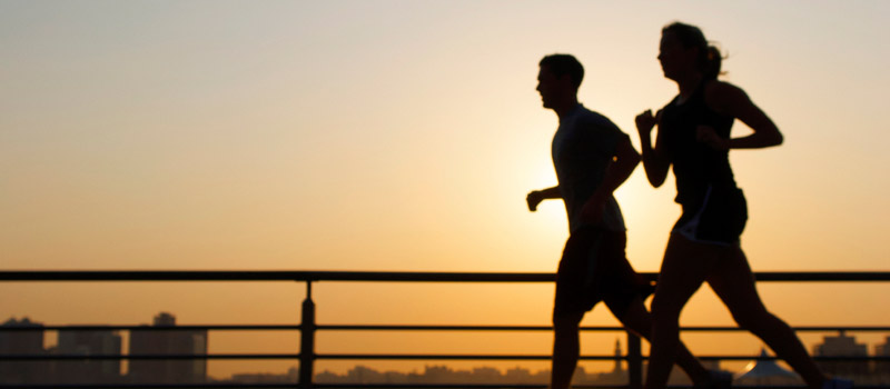 Photo: Silouette of Couple Running