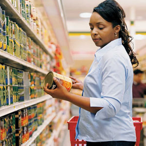 Photo: Woman Reading Ingredients in Grocery Aisle
