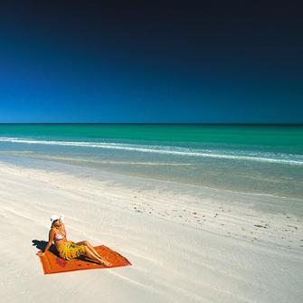 Photo: Woman Sunbathing on the Beach